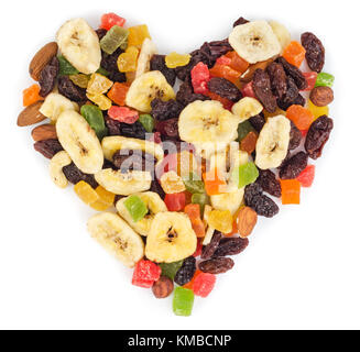 Dried fruits in heart form isolated on white background - Stock Photo