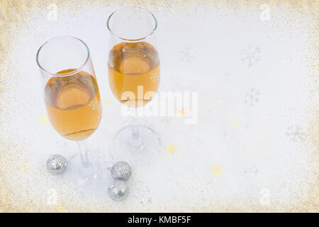 Two glasses of sparkling wine as happy new year concept inside a creative decorative frame - Stock Photo