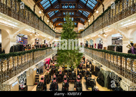 Christmas tree in atrium of Jenners department Store in Edinburgh, Scotland, United Kingdom - Stock Photo