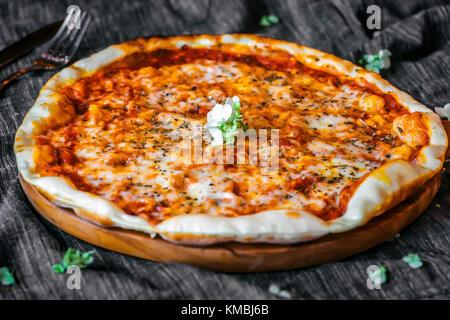 Close image of three cheese Pizza Margherita - Stock Photo
