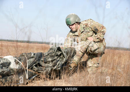 U.S. Army Staff Sgt. Michael Wagner assigned to the 18th Airborne Corps., return after completing his jump in participation - Stock Photo