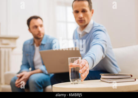 Glass with clear cold water standing on the table  - Stock Photo