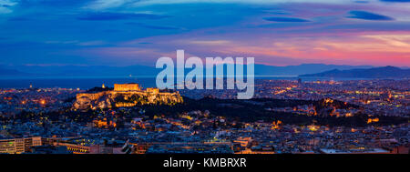 Panorama cityscape with the capital city of Athens in Greece, at night - Stock Photo