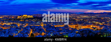 Panorama with Athens in Greece at night - Stock Photo