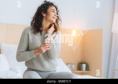 Beautiful young lady thinking of something pleasant - Stock Photo