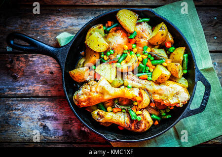 Oven Baked Chicken With Potatoes And Vegetables On Wooden Background - Stock Photo
