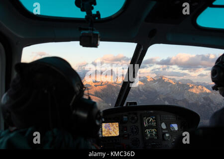 Interior of the cockpit of helicopter in flight on the Dolomites, South Tyrol, Italy - Stock Photo