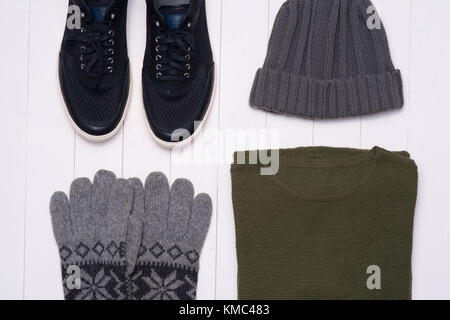 Men's winter casual outfits with accessories on wooden background - Stock Photo