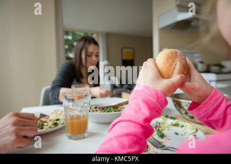 Family having breakfast in kitchen - Stock Photo