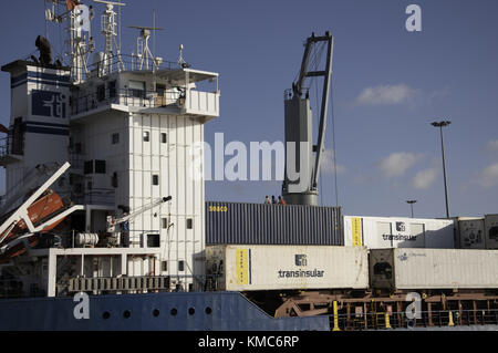 Container ship being unloaded in Praia harbour in Santiago, the main island in the Cape Verde archipelago in the - Stock Photo