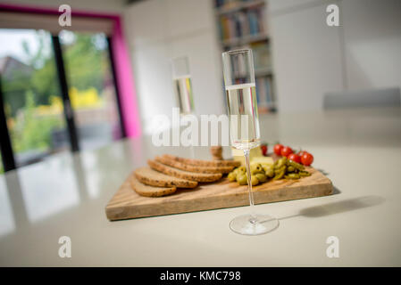 Champagne Flutes and Food on Kitchen Counter - Stock Photo