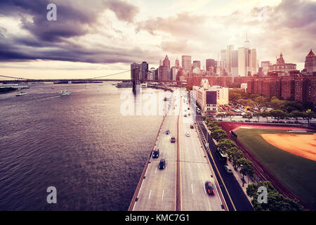 Dramatic sunset over Manhattan, color toned picture, New York, USA. - Stock Photo