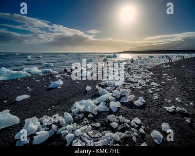 Ice formations on black sand beach. Ice comes from the Breidamerkurjokull Glacier, Vatnajokull Ice Cap, Iceland. - Stock Photo
