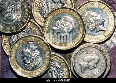 One pound coins, and twenty pence and five pence pieces, totalling £7.50, representing the UK's National Living - Stock Photo