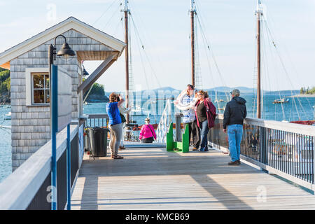 Bar Harbor, USA - June 8, 2017: Pier with tour ship sail boat Margaret Todd Windjammerand people taking tourist - Stock Photo