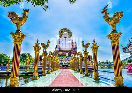 Statue of Budai in Buddhist Temple Wat Plai Leam on Samui island, Thailand - Stock Photo