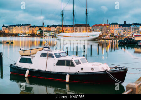 Helsinki, Finland. Marine Boat, Powerboat In Evening Illumination At Pier. - Stock Photo