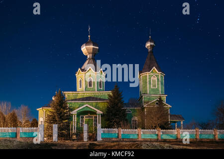 Old Russian Wooden Orthodox Church Of The Holy Trinity Under Night Starry Sky In Village Krupets, Dobrush District, - Stock Photo