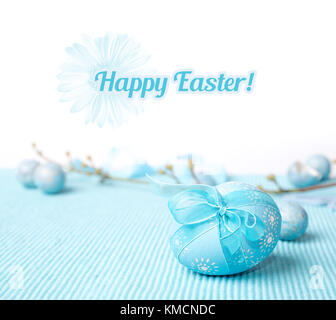 Light blue background with ornate Easter egg and a caption 'Happy Easter' on white background. Space for your text - Stock Photo