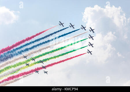 Fursan Al Amarat (UAE flight performance squadron) in the air during a flight on a summer day. Dubai, UAE. - Stock Photo