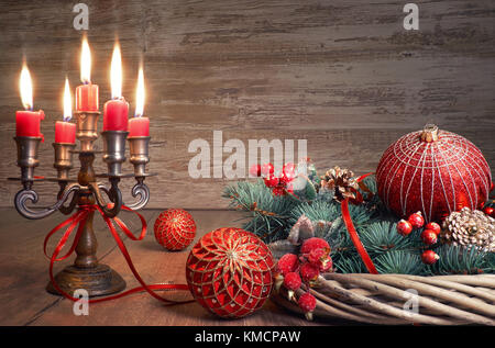 Vintage Christmas decorations in red and green on wooden background, toned image with space for text - Stock Photo