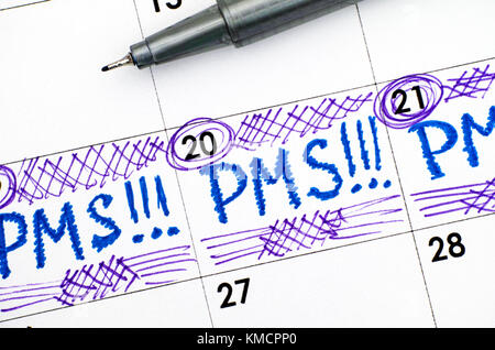 Reminder PMS in calendar with pen. Close-up. - Stock Photo