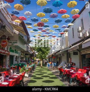 Outside gastronomy at umbrella street, 2. Inoenue Sokak, old town of Kaleici, Antalya, turkish riviera, Turkey - Stock Photo