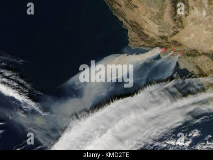 California, USA. 06th Dec, 2017. Smoke from massive forest fires burning in Southern California fueled by Santa - Stock Photo