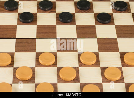 checkerboard with checkers. game concept.board game.hobby.checkers on playing field for a game - Stock Photo