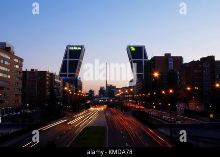 Paseo de la Castellana and KIO Towers, night view. Madrid, Spain. - Stock Photo