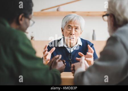 senior friends sharing stories - Stock Photo