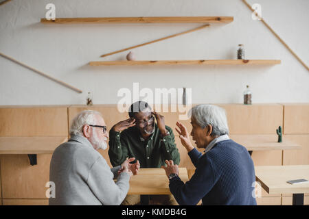 senior friends having discuss - Stock Photo