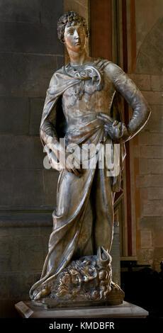 Marble statue of David by Donatello 1386-1466 , National Museum of Bargello , The Bargello, Palazzo del Bargello, - Stock Photo