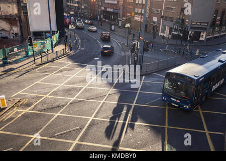 BIRMINGHAM, UK - DECEMBER 01, 2017: Elevated View over Busy Junction with Passing City Bus - Stock Photo