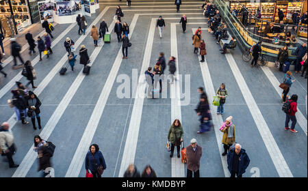 BIRMINGHAM, UK - DECEMBER 01, 2017: People in motion at busy rail station - Stock Photo