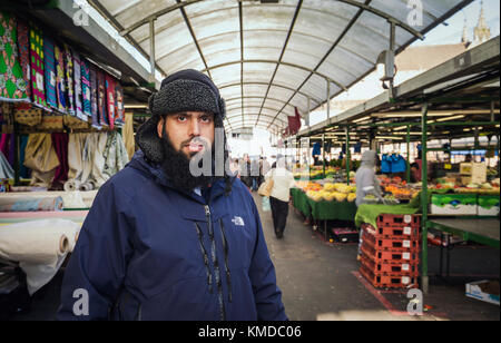 BIRMINGHAM, UK - DECEMBER 01, 2017:  Portrait of Asian Stall Market Salesman at Bullring Market - Stock Photo