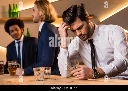 drunk businessman in bar  - Stock Photo