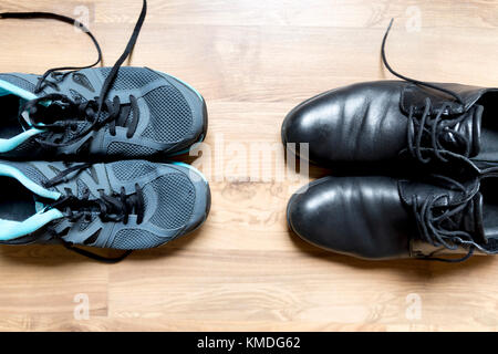 After work activity concept. Office shoes and sneakers, ready to take a run - Stock Photo