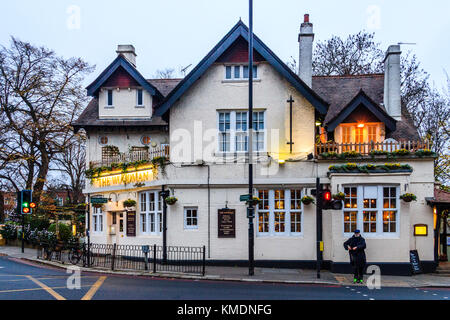 The Woodman public house on the corner of Muswell Hill Road and Archway Road, Highgate, London, UK, on a December - Stock Photo