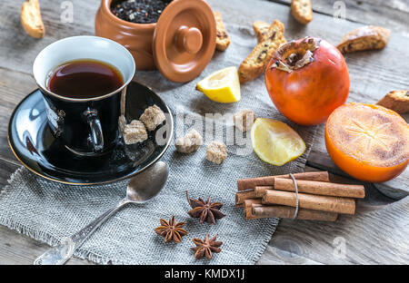 Fruit tea with spices and cookies - Stock Photo