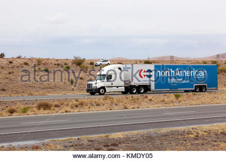 Semi-tractor pulling moving van Beltmann Relocation Group North American Moving Services on interstate in southeasterrn - Stock Photo