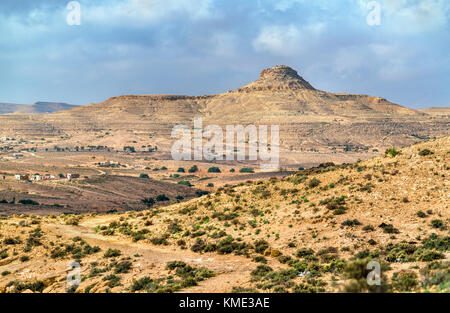 Typical South Tunisian landscape at Ksar Ouled Soltane near Tataouine - Stock Photo