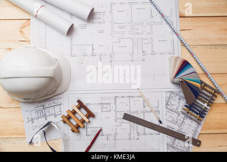 Architecture drawing desk, construction site working with blueprints in the office top view - Stock Photo