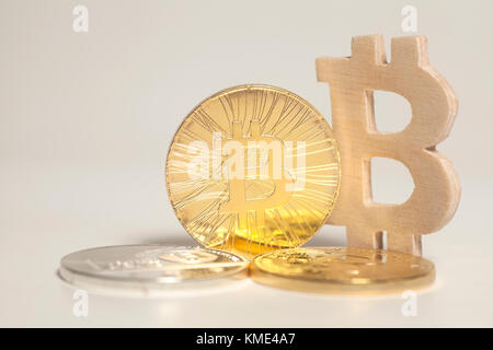 Bitcoin coin end bitcoin wooden sign isolated on a white background. - Stock Photo