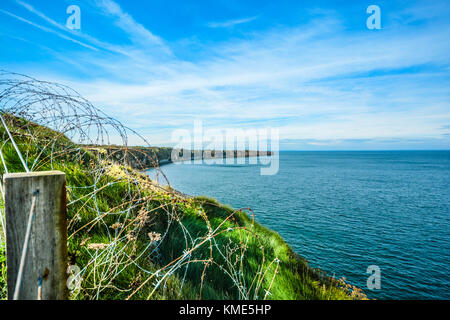 Pointe du Hoc, the battlefield memorial for the D-Day invasion on the coast of Normandy France with cliffs, the - Stock Photo