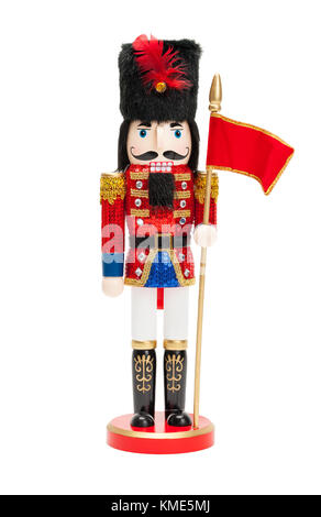 Wood Nut Cracker Doll with Black Hat and Red Flag Isolatedo on a White Background. - Stock Photo