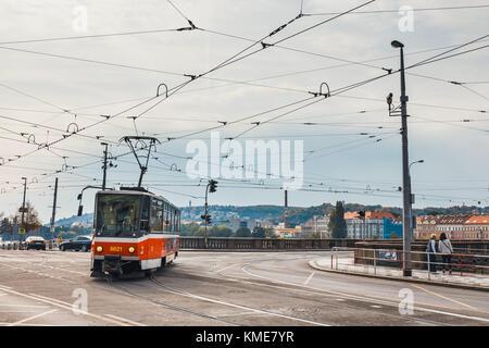 Prague, Czech Republic, October 01, 2017: Red tram goes on old town in Prague. Prague's major public transport operator is The Capital City of Prague
