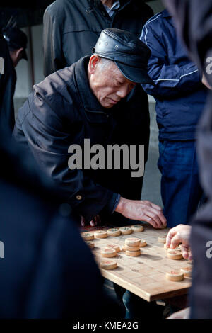man playing Chinese chess (Xiangqi),Temple of Heaven,Beijing,China - Stock Photo