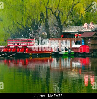 Dinner boats await customers at early twilight,Shichahai (Houhai) District at Twilight,Beijing,China. - Stock Photo