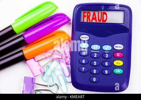 Writing word Fraud text in the office with surroundings such as marker, pen writing on calculator. Business concept - Stock Photo